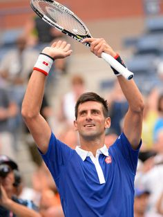 Novak Djokovic of Serbia celebrates after beating Joao Souza of Brazil 6-1, 6-1, 6-1 on day one of the 2015 US Open at USTA Billie Jean King National Tennis Center.  Robert Deutsch-USA TODAY Sports