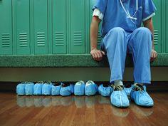 Medical worker in scrubs, sitting in a locker room.