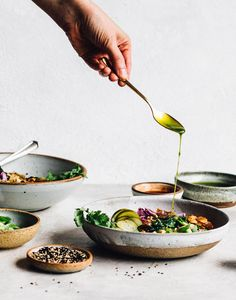 Drizzling cilantro oil on congee rice bowls, with sesame seeds in foreground. Food Photography Styling, Food Styling, Dried Mushrooms, Stuffed Mushrooms, What Is Congee, Olives, Hummus, Coconut Bacon, Inexpensive Meals