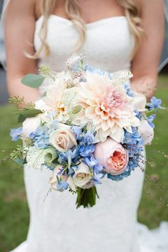 bouquet of cafe au lait dahlias, roses, garden roses, blue hydrangea, and delphinium