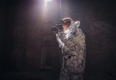Picture Organic Clothing's camo jacket for wildlife photographer and reporter Loïc Lechelle. fig.: Special highlight of the FW2017/18 collection by Picture Organic Clothing is the 'Central Camo White Leaf Jacket' which was developed for wildlife photographer, filmmaker, reporter and polar guide Loïc Lechelle's outfit for the making of the report about the endangered species snow leopard in Siberia. The jacket - on view at the image below, protects visually (camouflage print) and from cold.
