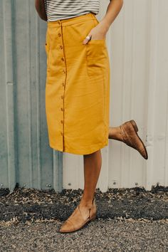 """Mustard Midi Skirt Wooden Button Down Front Side Pouch Pockets Subtle A-Line View Size Chart Model is 5'9"""" + Wearing a Medium"""