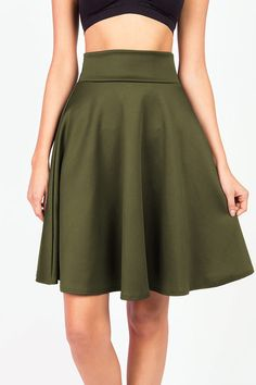 """Classic midi skater skirt with a stretchy waistband. Pair with your favorite tee and knee highs for a cute and casual look. *Hand or Machine Wash Cold *90% Polyester 10% Spandex *23.5""""/ 60.5cm Top to"""