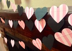 10 Feet Long! Victoria Secret Pink & Black Inspired Heart Garland Birthday Party Decor, Bachelorette Parties, Baby Shower Decor, Etc! Hearts are 2.25 wide. This is made from heavy card stock and the hearts have been machine stitched with transparent thread to give a true floating effect. Each end is finished with white ribbon that makes it easy to hang the garland. Or simply snip off the length you want and hang with thumb tacks or drape any way youd like. When hanging, the hearts on thi...