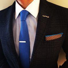 The Details: Tie - Blue Knit; Lapel Pin - Silver Mustache; Tie Bar - Antique Silver; Pocket Square - Turquoise Polka Dots. Available @ www.suitedman.com