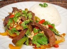 Thai Beef Stir Fry - this site looks like it has a lot of good recipes. I need to remember to investigate more.