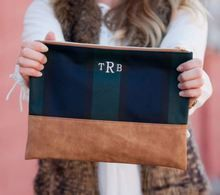 You'll love this adorable and versatile tartan plaid cosmetic bag featuring your embroidered monogram.