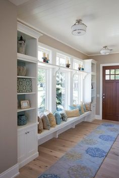Beautiful entry hallway. I think I'd try to find a way to use the space under the bench for added storage.