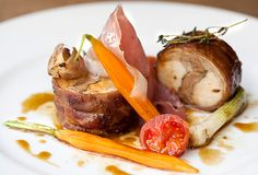 Roast saddle of rabbit wrapped in prosciutto