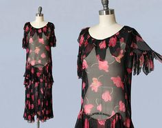 Beautiful 1920s era dress. Light as air, sheer, soft silk chiffon in a black and pink floral print. Features petal collar and sleeve trim. Fluttery, capelet style sleeves. Bias cut ruffle tier at hip, lovely movement, flattering angled deco seamwork. Skirt is light, voluminous, and flowy. Side snap closures. Absolutely stunning and ethereal!! LAYAWAY is available for all items, please message me for details. Measurements: *meant to fit loosely. Recommended for a size XS-M Bust: 38 Hip: 42…
