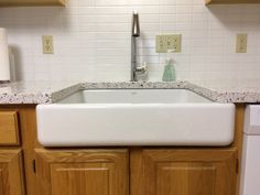 We love this Kohler Whitehaven farm sink with a touchless faucet that the Shedlock family selected.