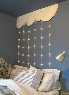 Hannah's bedroom. Curtain rod, star twinkle lights and sheers.