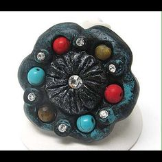 Turquoise and Stone Deco Flower Ring Turquoise and natural stone deco flower stretch ring.  Multi-color Ring 45 x 45 mm stretch Stretch  2 in stock. Jewelry Rings