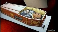 Coffins Costumes And A Cake On A Gurney