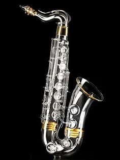 World's most expensive saxophone; completely handmade with a glass plated exterior finished with 2.82 ounces of gold and ten 2-carat diamonds. I want it.