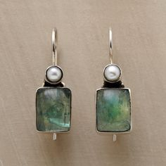 """MARINA EARRINGS -- Apatite's aquatic hue harks back to the watery origins of cultured freshwater pearls atop the blue-green cabochons. Sterling silver. Locking French wires. 1-1/8""""L."""