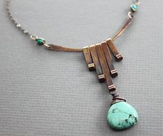 This really beautiful and organic copper necklace made with hand forged bars, assembled in Art Deco design, accented with howlite turquoise stone, suspended from an arch accented with small turquoise beaded connectors and then finished up with a delicate copper chain and handmade hook clasp.  PLEASE EXPECT SOME VARIATIONS IN STONES TEXTURE AND VEINS.  The pendant is 2.5(6.3cm) long and 2(5.0cm) across.  ★ ★ ★ ★ ★ ★ ★ ★ ★ Enter my shop here: http://ingodesign.etsy.com ★ ★ ★ ★ ★ ★ ★ ★ ★