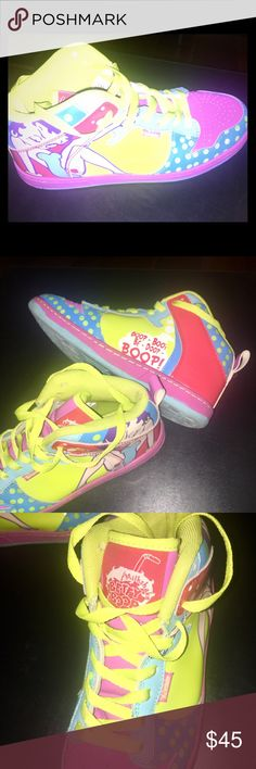 """Betty Boop High Top Sneakers You don't come across a pair of these bad boys (or should I say 'girls') everyday! These rare Betty Boop High Tops feature bright pink, neon yellow, baby blue, red & purple color-blocking w/ a pink rimmed traction lined rubber sole & yellow laces, a timeless cartoon image of Betty herself exuding what else? Sex Appeal! The opposite side has her famous mantra """"Boop Boop Be Doop Boop"""" in text at the heel. In EUC & ready to fit your feet & get those heads turnin! A…"""
