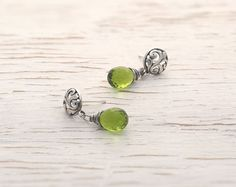 Hey, I found this really awesome Etsy listing at https://www.etsy.com/listing/199197172/green-peridot-stud-earrings-drop-earring