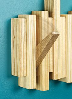 Sporting a mid-century vibe, this coat rack is one part wall art, one part handy place to park your jacket, or hat. Woodworking Shop, Woodworking Projects, Wall Hangers For Clothes, Woodsmith Plans, Small Wood Projects, Coat Hanger, Down Coat, Furnitures, Texture
