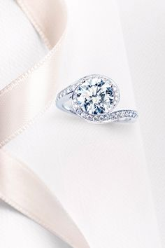 De Beers | Our Caress Engagement Ring #EngagementRing #ADiamondisForever