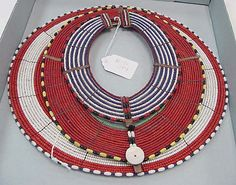 Necklace of glass beads, metal, leather and shell from the Maasai people of Kenya circa early 20th century.