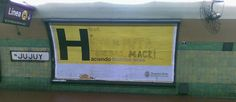"""""""H"""" - yellow campaign first used by Mayor Macri in Buenos Aires to get elected and then rebranded to show achievements of his administration. Here the original slogan """"Haciendo Buenos Aires"""" (doing/making Buenos Aires) was changed into """"Hijo de puta que sos Macri"""" (Macri you son-of-a-bitch) by someone not happy with the achievements...photo taken in the subway."""