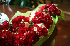 so beautiful  http://thefullbouquetblog.com/2011/12/20/red-and-gold-wedding-flowers-christmas-wedding/#