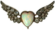 a Victorian opal and diamond brooch formed as a winged heart, set in silver and gold