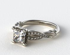 I have recently fallen in love with this look for a ring. I of course would rather it be white gold as oppose to platinum. And i want a sapphire in the middle and not a diamond, but same style.Platinum Pave Crossover Engagement Ring