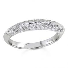 BF1355 - #23434  18 k, white diamond band 0.24 ct. rounds (Please call for pricing)