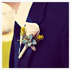 white rose and succulent boutonniere