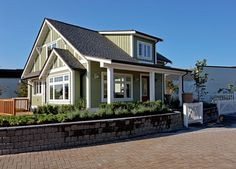 "This unique small-footprint custom-built prototype ""cottage-style"" home in Tsawwassen signals the emergence of a trend toward smaller housing, especially in the detached single-family form. This home meets the current desire for a simpler, energy efficient, sustainable and convenient form of housing that fills the needs of both a shrinking family household and the lifestyle needs of"