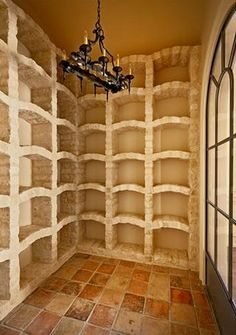 Wine Cellar with all stone wine storage 'racks'...