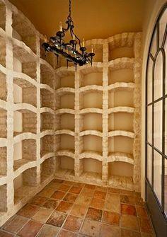 Wine Cellar with all stone wine storage 'racks'...