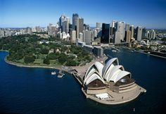 Sydney (Australia) - Opera House in the foreground with the Royal Botanic Gardens and Government House behind, then the CBD skyline and Circular Quay on the right, where the largest cruise ships berth.