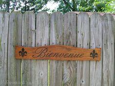 My Repurposed Life-repurposed headboard sign {bienvenue} with SPRAY PAINT!