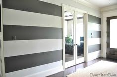 Tutorial for how to paint perfect wide stripes on a wall. Megan painted the str. Tutorial for how to paint perfect wide stripes on a wall. Megan painted the stripes in one of my favorite colors- Urbane Bronze by Sherwin Williams. So awesome! Paint Stripes, Wide Stripes, Gray Stripes, Style At Home, Striped Walls, Striped Hallway, Decoration Inspiration, Nursery Inspiration, My New Room