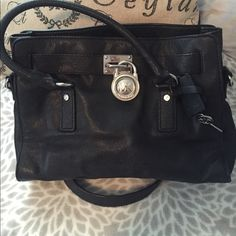 Michael Kors Hamilton Bag in Black Michael Kors Hamilton Bag. Gently Used. Excellent condition. Silver hardware with lock and key. 2 short carrying straps and a long shoulder strap, so you can carry 1 of 2 ways. Price is firm :) Michael Kors Bags