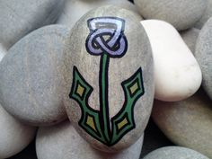 Beautiful Scottish Thistle with a Celtic twist in metallic purple and green. The design is drawn freehand, painted with acrylics and sealed with