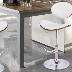 This modern barstools is sure to be the envy of all your friends. Sip your drink in style perched on a chair-style seat with all-over foam cushioning. The comfy chair is supported by a chrome-finished, adjustable base that is easily raised and lowered with a lever under the seat.