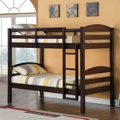 Elegance and function combine to give this contemporary wood bunk bed a striking appearance. This safety-certified bed includes full-length guardrails and an integrated ladder. Unlike other twin bunk beds, this bed also converts into two twin beds.