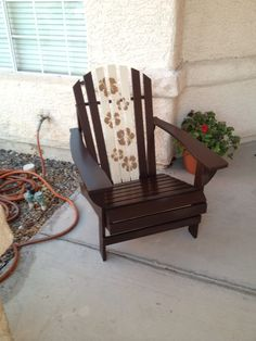 Home Depot pine Adirondack chair kit for $38. A couple cans of Rustoleum espresso  and ivory satin paint and some stencils...  Instant Tommy Bahama summer chair