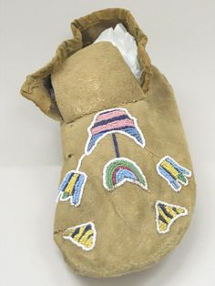 Blackfoot (Native American). Moccasin with Beaded Floral Decoration, late 19th century. Hide, cloth, beads, 11 x 4 1/8in. (28 x 10.5cm). Brooklyn Museum, Robert B. Woodward Memorial Fund, 26.796. Creative Commons-BY (Photo: Brooklyn Museum, CUR.26.796_view1.jpg)