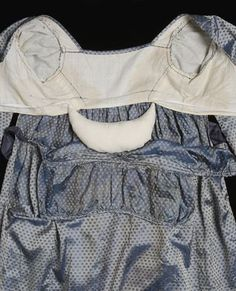 Bodice interior showing reconstructed bustle pad made by Museum conservators for display purposes.