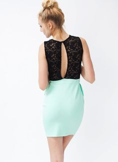 You'll look gorgeous rocking this lace peplum contrast dress.