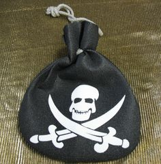 Pirate Pouch - Perfect for you pirate loot. This bag can also hold the extra lipstick or coins. This pouch is a soft black foamy-like material with a skull and crossed daggers on it. #yyc #costume #pirate