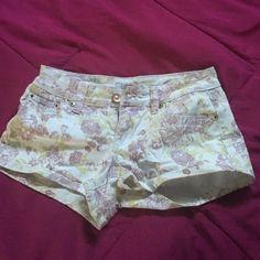 Floral, white shorts Floral shorts. Runs pretty small. Short shorts YMI Shorts