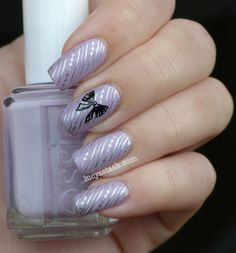 Essie and A England Bow nail art manicure ~ I've used Essie Nice Is Nice, A England Camelot and A England Excalibur and I've added silver stamping to add a femininity and shine to it. ~ by Lucy's Stash