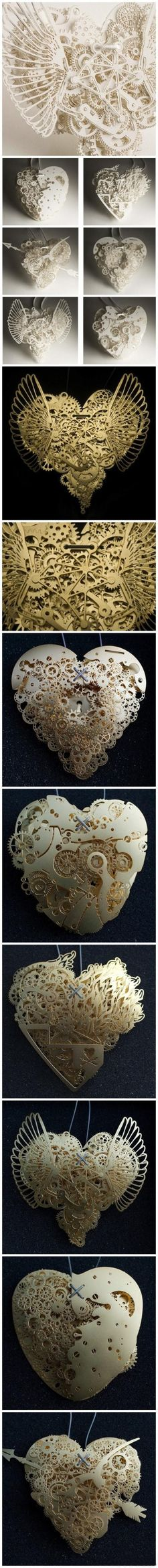 Mechanical heart paper sculptures make our 'foldy' business cards look amateur.